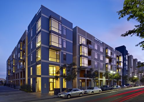 An evening view of 335 Berry Streetr showing both the Berry St. and the mid-block elevations.